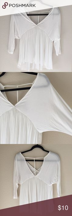 White Flowy T-back Top The top part and arms are normal (soft) fabric, and the bottom half is flowy chiffon material.  In like-new condition, super cute to wear with a halter bralette :) Forever 21 Tops Blouses