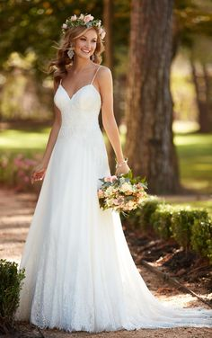 This sexy lace wedding dress from Stella York is lighter than air with chiffon and corded lace, making your walk down the aisle dreamy. Sexy spaghetti straps and a sweetheart neckline frame the face. The low-cut back zips up with ease under nine fabric-covered buttons. The train fans out with an elegant spray of scalloped lace.