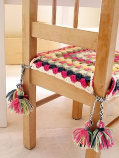 Fun crochet seat covers for the kitchen table. Maybe (Granny square chair cover with tassels)