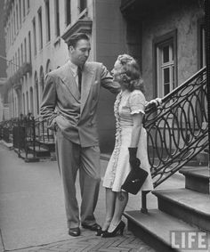 A businessman flirting with a young lady after work, 1946.