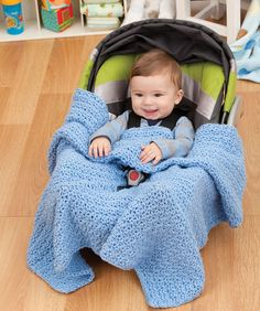 Car Seat Blanket {free pattern}~ The nice thing about this crocheted blanket is that it stays where baby needs it. There are openings for the seat strap and the shoulder straps, so it's perfect for keeping baby snug and cozy while you keep your eyes on the road.