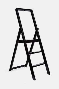 Malmvall's Step, designed in 2010 for Design House Stockholm, is a foldable stepladder that is beautiful enough to be hung flat on the wall rather than stowed in a closet. A small hook is included for just that purpose. Crafted of solid beechwood lacquered to a glossy black, the ladder has three steps and a bar to grasp for stability.