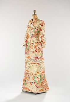 ~1958 evening dress by Marguery Bolhagen (American). Created from a finely woven Japanese obi provided by Mrs. William Randolph Hearst, Jr. The obi was originally given to Mrs. Hearst from Prince Takamatsu (1905-1987) and his wife, Princess Takamatsu Kikuko (1911-2004) who were heirs to the Arisugawa-no-miya branch of the Japanese Imperial family.