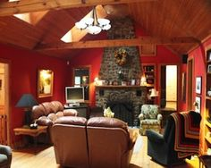 This three-bedroom, two-and-a-half bathroom classic Adirondack Craftsman in Austerlitz has an open floor plan with nearly 3,000 square feet. A massive stone fireplace, hardwood floors, and exposed beams bring in the Craftsman feel — and that's just in the main house. Sited on 70 wooded and garden-graced acres, the house is joined by a guesthouse and caretaker's cottage, each containing two bedrooms. Also on the grounds: a trout pond with waterfall, stone walls, and multi-level outdoor…