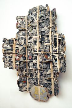 "Amazing book art by Brian Dettmer: American Peoples, 2011, Hardcover books, acrylic medium, 61"" x 39"" x 14"" (154 x 100 x 34 cm) - Image Courtesy of the Artist and Toomey Tourell Fine Art"