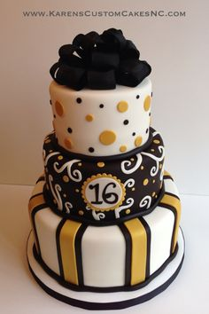 3-tier all fondant cake (10+8+6). White, gold and black. Real ribbon bow.