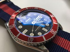 """Seiko mod with red """"sub"""" bezel insert and double domed sapphire crystal w/ blue AR coating. Seiko Skx007 Mod, Seiko Mod, Best Looking Watches, Tudor Heritage Black Bay, Seiko Diver, Skeleton Watches, Seiko Watches, Mechanical Watch, Luxury Watches"""