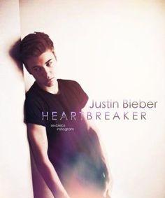 He's so freakin' hot! I love heartbreaker! It's such an amazing song! I love the part when he starts talking. Omb I die!