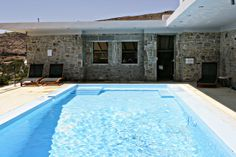 #vacation villa in #Tinos with private swimming pool with salt electrolysis and hydro-massage installations where guests can swim or relax on the comfortable sun beds http://www.tinos-habitart.gr/green-house.php