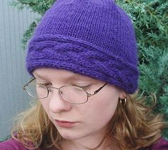 This hat is simple, so it's easy to knit and the cabling stands out. http://knitty.com/ISSUEwinter03/PATTcoronet.html