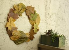 What a gorgeous way to use fallen leaves! Decorate your home with this Pressed Fall Leaves Wreath | AllFreeKidsCrafts.com