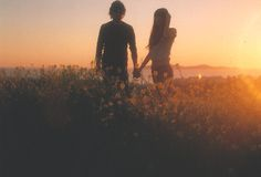 boy and girl, hand in hand, sunset flower field :) this is my dream place.