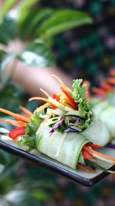 Fresh Spring Rolls: an elegant and ultra-fresh appetizer (raw, vegan). Look superb anywhere, anytime! shredded crispy veg assortment and bit of ruffly lettuce rolled in cucumber shavings. Plant Based Recipes, Raw Food Recipes, Vegetarian Recipes, Cooking Recipes, Healthy Recipes, Fresh Spring Rolls, Summer Rolls, Vegetable Appetizers, Healthy Snacks