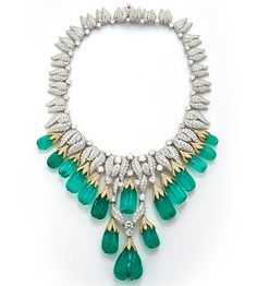 David Webb emerald and diamond necklace, set in 18-carat yellow gold and platinum featuring 16 fluted Colombian emeralds and 1,658 diamonds weighing roughly 65.87 carats.