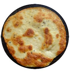 2 cups plain flour     1 cup plain yogurt     1 tsp kalonji seeds (available from Indian stores)     2 tsp baking powder     1/2 tsp salt     Oil or ghee for frying