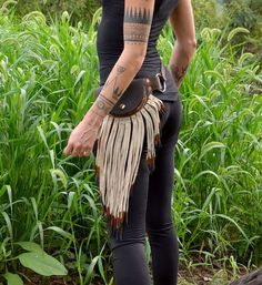 arm tattoos and leather pouch belt. This picture was found by stone98