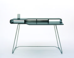 Loop Desk/Cappellini |  Desk from the loop family of products. /  Date - 1999 Manufacturer - Cappellini Materials - Lacquered laminated birch ply and stainless steel Dimensions - 1350 × 650 × 840