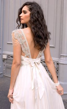 Anna Campbell Bridal Grace Wedding Dress    Featuring delicate hand-beaded shoulder detailing, an elegant low back and a shimmering silver hand-embellishment, the vintage-inspired Grace bridal gown epitomizes whimsical and glamorous.
