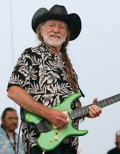 WILLIE NELSON / Probably not a Steinberger made guitar, but it seems to be a similar custom made headless guitar.