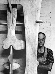 Isamu Noguchi in his studio.  Wonderful bio and more pictures here: http://blog.ptthead.com/architecture/isamu-noguchi