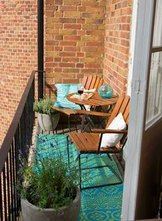 Keep it simple with plants in planter boxes to keep the balcony inner space uncluttered