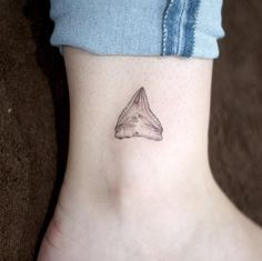 Stunning shark tooth tattoo by Doy