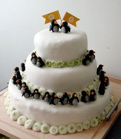 penguins. They are a Fav of my Oldest Kye....maybe someday this would make a cute Grooms cake. Not up to me....but cute.