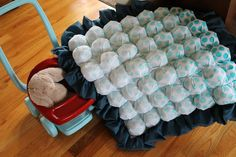 "Bubble quilt. 6""x6"" squares over 4.5""x4.5"" squares, pleated, sewn together and stuffed.  Then sewn to a blanket backer."