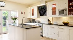 <b>White</b> <b>Shaker</b> <b>Kitchen</b> With Red Interiors from Harvey Jones