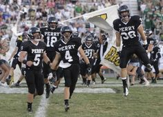 The Perry Panthers take the field for the game against Central Catholic in week 2 of the high school footbal season.