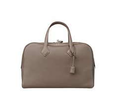 "Victoria II Travel Hermes tote bag (size 43) Taupe taurillon clemence leather<br />17"" x 11""x 8""<br />Canvas lining. With handles, height is 11""."