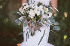 anemone and eucalyptus bouquet, photo by Kelsea Holder http://ruffledblog.com/cambria-pines-lodge-wedding #flowers #weddingbouquet