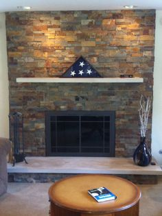 Real Stone Systems Stone Fireplace Face  Wood Burning   Design Specialties Carolina Glass Door  Limestone Mantel & Hearth