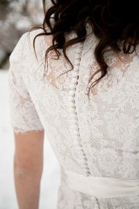 Illusion lace wedding gown with sleeves and buttons down train/ sheath wedding gown at Sweetheart Bridal