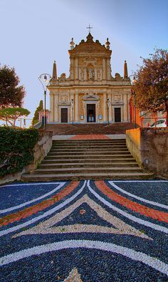 Patterns and shapes created by skilled craftsmen using stones from the sea, Ligurian churchyard, Italy