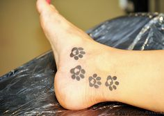 A single one of these paw prints would be a perfect foot tattoo!