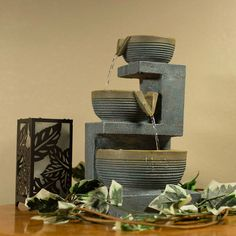 Create an indoor oasis with this stunning tabletop fountain. Painted in hues of light slate blue, gray, taupe and tan, the neutral color scheme is sure to please any office, bedroom, living room or den.