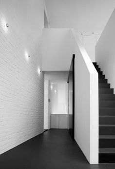 white brick wall with black flooring!