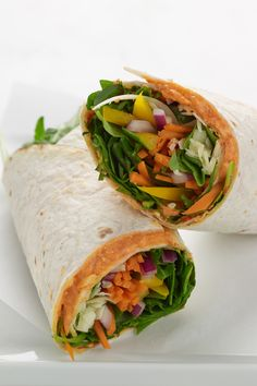 California Vegetable Wraps with greek yogurt roasted red pepper spread, arugual leaves, carrots, yellow bell pepper, red onion & cheddar cheese.