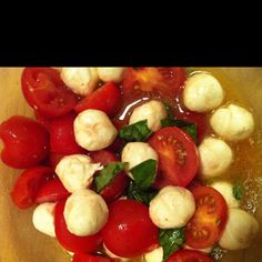 Tomato mozzarella basil salad! Yummo! 1/4 cup balsamic vinegar, 1/4 cup olive oil, 20 cherry tomatoes halved, 2 cups mozzarella cheese balls, 1 sprig of fresh basil ( cut up) , salt and pepper to taste.
