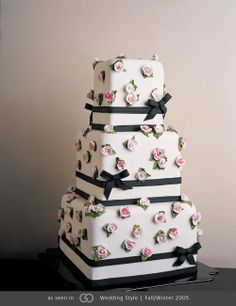 Miniature cake wrapped in black ribbon adorned in pink roses. @grace_ormande @wedding_style