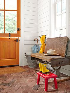 Quirky furniture and accessories such as an old New York City transit-car bench and a galvanized-steel olive bucket, used to hold umbrellas, lend oodles of character to this personality-packed mudroom.