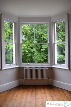 White column radiator is a beautiful addition to this bay window