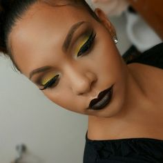 """BlackQueen!"" – white in eye duct area, blended into yellow all over lid, orange in crease right above yellow with a warm brown shade blended into orange in crease area. then a black shadow in outer v area. dark black lip!"
