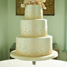 Wedding Cakes | Sylvia's Kitchen Three tier wedding cake finished with pearl lustre and hand piped gold lustered graduated beading, sugar Peony and buds, sugar Rose and buds, sugar Tulip and buds