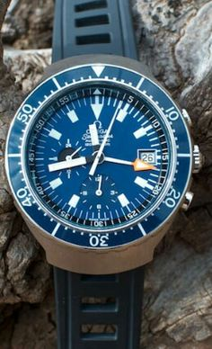 The Omega Seamaster Automatic 120m Chronograph (Ref.176.004) a.k.a. the Big Blue - The Omega Big Blue was a bold statement representing an era that has since irreversibly passed. It was a chronograph that, although produced in small numbers and for a short period of time, proved how important it is for a company to experiment with its offerings. A watch is more than the sum of its parts; the Big Blue's huge case that provides functionality, comfort and protection, the outstanding 1040…