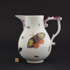 An 18th Century Meissen Porcelain Milk Jug with Wish-Bone Handle c.1740-1745. Painted in the Style of Johann Gottfried Klinger (1711-1781) with Shaded Holzschnittblumen (Woodcut Flowers) and Insects. The Base with Crossed Sword Marks in Underglaze Blue for the Meissen Porcelain Factory.