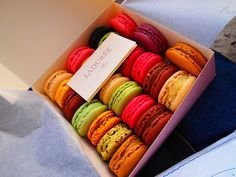 Laduree Macarons in the flavors Red Fruits, Chocolate, Pistachio, Chocolate with Passion fruits, and more.