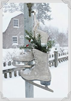 Hanging ice skates accented with snips of evergreen - Aiken House & Gardens: A White Christmas