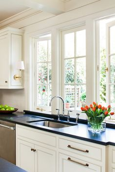 Sconces On Cabinets Above Kitchen Sink Window